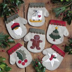 RACHEL'S OF GREENFIELD-Warm Hands Felt Ornament Kit. Make six 4x4-1/2 inch mitten ornaments each featuring a different wintertime image: gingerbread man; holly leaf; ice skate; Santa face; snowman sta