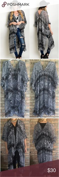 "Boho Chic Light Flowy Kimono Black & White This black & white lightweight kimono can be worn over your favorite outfit for an instant boho chic look. Even looks great over your swimsuit or nightie. Soft flowy poly fabric 43"" length.                                                           Small/Medium Fits 4/6/8 Medium/Large Fits 10/12/14 Sweaters Cardigans"