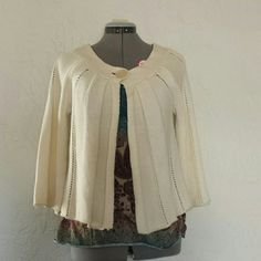 Nine West 3/4 sleeved. Has a small hole on the shoulder but may be able to be repaired. Nine West Sweaters