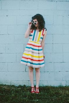 Elizabeth of Delightfully Tacky -- I've seen her wear this dress on her blog a few times and I am in love with it!!