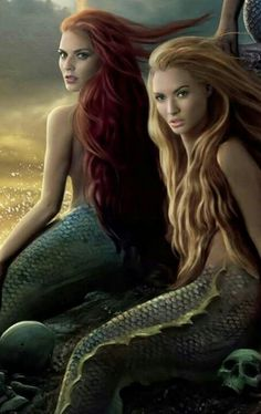 A blond mermaid (Ella) and a ginger mermaid (me). Our twinness was meant to be!!