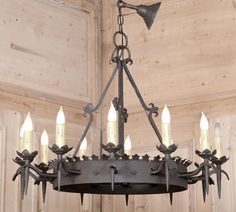 Vintage Gothic Wrought Iron Chandelier. Forged from solid iron in a rustic Gothic style, this heavy chandelier is perfect for the country home or provincial decor! No less than a dozen chandelles ensure plenty of light will be cast by the newly wired fixture, which survives with a short bit of chain and a canopy.   Circa early 1900s.