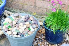 Make a water feature with beach glass and pebbles in a bucket. Instructions here.