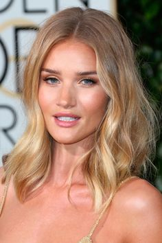 Rosie Huntington-Whiteley Works A Sleek Bun With A Flick Of Eyeliner, 2016