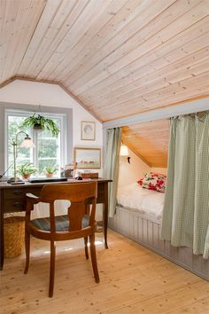 curtained off bed under sloped ceiling                                                                                                                                                                                 More