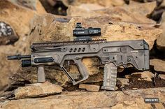 Steve Coulston embarked on a year long journey to transform his IWI Tavor into something very special. Military Weapons, Weapons Guns, Guns And Ammo, Tactical Shirt, Tactical Gear, Airsoft, Tavor Rifle, Weapon Of Mass Destruction, Tac Gear