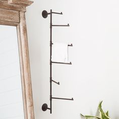 Hang up your outerwear to your towels when using our Industrial Swivel Pipe Coat Rack.  This movable piece features an industrial style while offering function to your foyer or bedroom. Hanging hardware is not included. Boys Industrial Bedroom, Industrial Wall Hooks, Industrial Coat Rack, Industrial Closet, Industrial Pipe, Vintage Industrial, Industrial Design, Old Ladder Decor, Ladder Towel Racks