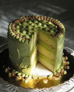 "OMG, heaven!  Ginger-Green Tea Cake.    ""Vanilla-buttermilk cake iced and filled with our delicious green tea buttercream; layers of icing studded with bits of zesty crystallized ginger."""