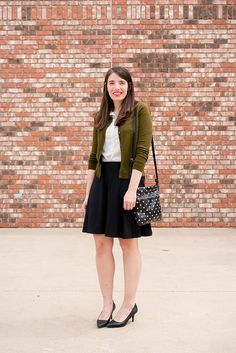 Wear a circle skirt to work. Polka dot blouse, green cardigan, black circle skirt. Teacher outfit. Casual chic. Fashion. Fashion Blogger. Spring outfit idea. Summer outfit idea. @justjacq