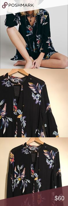 FP Electric Orchid Print Swing Tunic Like new swing tunic from Free People, only worn about once  or twice. Keyhole opening at bust and pockets below waist. Stretchy smocking mid-arm with gathered elastic cuffs. No trades. Free People Tops Tunics