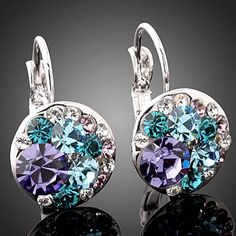 We can't help but be mesmerized by the shades of blue, pink, white and purple in these clustered Swarovski Element crystal drop earrings. Choose from 18K white gold-plated or Italian rose gold-plated settings and pair these with a simple outfit to dress it up or with your favorite dress for an event. Better yet? Get an extra set as a perfect holiday gift (these lovely earrings come in a gift box ready to give).