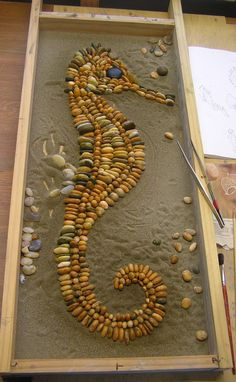 Seahorse in progress, October 2013. Mix of bought and collected South Island stones, large black Ngakawau stone for the eye. Still deciding on background - probably flat greens.