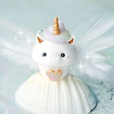 @theclaycroissant Unicorn Cupcake! (Pegasus? Because wings? Lol)  I don't normally like to add a lot of fake sparkles to my photos but dang it, it's super cloudy and it's making me grumpy so sparkles it is!  I'll take better photos of this little one when I have good lighting. :) And let me just say, on a totally random note, there is seriously nothing quite like the smell of banana bread baking in the oven on a cold, cloudy day. Ahhhhh  #polymerclay #claycharms #clay #charms #jewelr