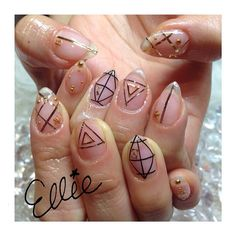 erinarita:  Clear w/ Gold&black design #clearnail #nail #nailart #gelnail #linetape #tapeart #triangle #star #studsnail