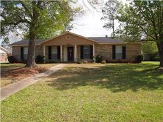 This is the one you have been waiting on!  Well maintained brick home in popular subdivision in Saraland School district. No carpet-- Hardwood and tile throughout.  The home boasts stainless steel kitchen appliances, a breakfast bar,  formal dining room, and a bonus den/family room. Lovely curb appeal with mature flowering trees and nice landscaping. The private fenced back yard has a large sun deck with trellis, an above ground pool, and a spacious man cave/storage building.  The roof was…