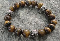 Check out this item in my Etsy shop https://www.etsy.com/listing/114093095/mens-bracelet-tigers-eye-stone-bracelet