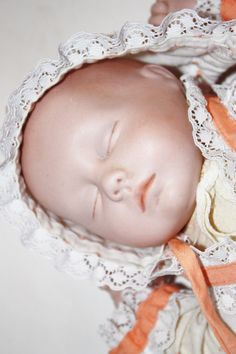 Bisque baby doll, baby doll, vintage doll, vintage baby doll, porcelain baby doll, sleeping baby doll, cloth baby doll.