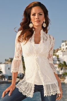 Crystal button-front blouse with velvet-ribbon drawstring at empire waist and flowy embroidered hem and cuffs.