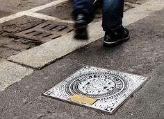 Manhole Cover by Shepard Fairey - The Don Gallery and the city council of Milan, Italy worked with street artists to design 20 manhole covers