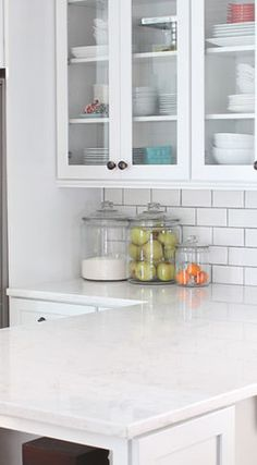 I would choose a countertop like engineered quartz, it's supposed to be very easy to maintain and is virtually indestructible.  And you can get it in finishes that look like marble.