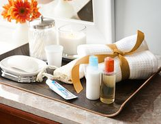 Organize bathroom essentials on trays.