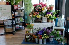 Studio Choo, San Francisco, CA; pop-up flower shop, flowers massed by type in simple containers