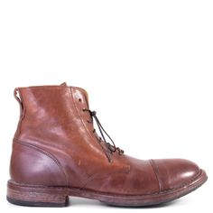 Emilio by MOMA is a traditional lace up ankle boot. Handcrafted with a smooth leather upper with a vintage inspired finish, this ankle boot will add sophistication and edge to your outerwear. The versatility that Emilio by MOMA possesses will have you turning heads everywhere you go.  FREE Shipping in the contiguous USA Men's lace-up boot Handmade in Italy Smooth Italian calfskin Leather upper, lining and footbed Hand stitched leather sole with rubber protection 1 inch heel Lace-up style…