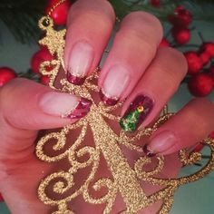My first Christmas nail art design in bluesky gel polish with gold glitter, green glitter and yellow 2mm rhinestone.