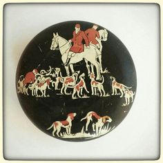 an old tin with an English hunting scene to hold your small treasures.