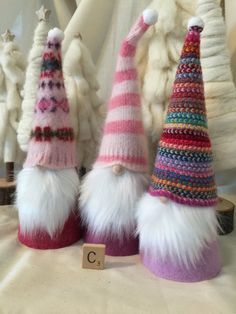 Why have an elf on the shelf when you can have a gnome in your home? I have handcrafted each one with love, utilizing a colorful striped Scottish wool scarf and super soft and fuzzy, pink striped angora sweater and felted pink fair isle lambswool sweater for their hats, hand stitched with embroidery floss. Each personality comes to life through their long wool felt coats in shades of raspberry and lavender, and cheerful bright white faux fur beards. Their unique hats are topped off with a…