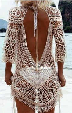 Exotic Beach Kimono in crochet embroidery design. As resort wear / beach coverup Rock it with a sexy white bikini! Fit: Sizes 2, 4 and 6 (see note) Material: Spandex and Nylon Color: White or Cream Pa