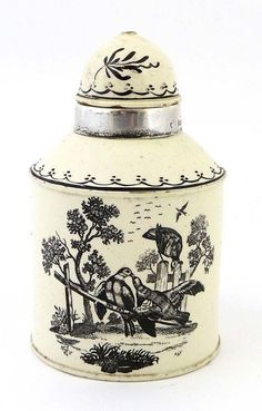 A late 18th c. Leeds cream ware tea caddy, with domed lid, decorated w/ opposed black transfer pastoral scenes..