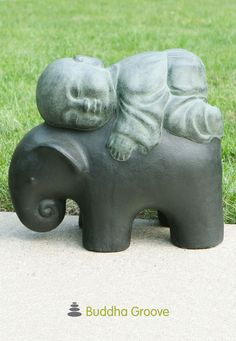 Bring a little tenderness to the outdoors. This statue of a baby monk resting on an elephant pulls right on your heartstrings! A gentle reminder of the love between humans and animals, this statue is made with a rustic finish in soothing colors of black and aged teal.