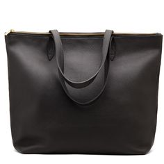 Some say luxury and practicality don't mix. This bag begs to differ. The silhouette is simple, but beautifully so. The pebbled leather is genuine Argentinian and the smooth leather is premium Italian, both lightweight and seriously soft, yet durable and sized just right for work or a weekend getaway. A marriage of form and function designed to impress - and crafted to last. Now available with a new, gorgeous gold zipper: so that your essentials are always secure.