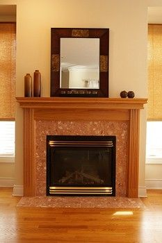 Mirror over the fireplace. (Not this exact one, but just for the idea)