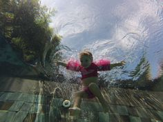 Say cheese! Barbara Phillip's 2 year old daughter hams it up for the GoPro even when she's underwater.
