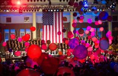 "Shower of maroon and gold balloons during the performance of ""Stars and Stripes Forever"""
