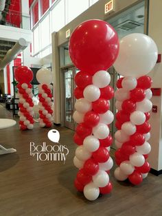 Red and white balloon columns for Value City Furniture's grand opening on Elston in Chicago | Balloons by Tommy | #balloonsbytommy