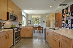 Modern Home | Modern Kitchen | Kitchen Aid | Glass Tile Backsplash | Concrete Floor | Elevated Ceilings | Mueller Homes Austin Texas | Mueller Development | Tilley ST Row Homes, www.muellersilentmarket.com