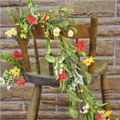 Add a splash of springtime color to your decor! This gorgeous garland of red and yellow hibiscuses accentuated by a variety of greens, is so life-like and would look lovely draped over a mantle, table, archway or stairway. #country #decor #artificial #spring #flowers