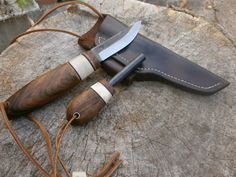 This Puukko, with a blade length of 77mm, has a brass lanyard tube and leather lanyard, but this time with an antler bead.  He also wanted a matching ferro-rod.  Both the knife and the ferro-rod are housed in a right-handed 4mm thick veg-tanned leather sheath, dyed dark brown, stitched with light brown linen thread.