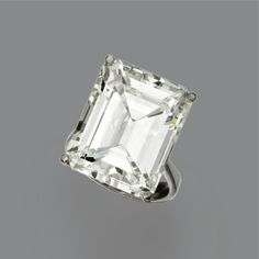 DIAMOND RING The emerald-cut diamond weighing 20.35 carats, in a simple white gold mounting