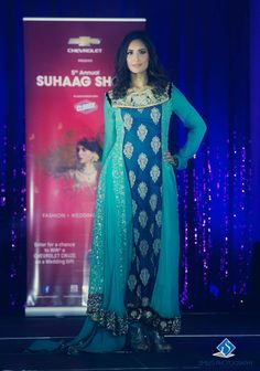 Model walks the ramp in another stunning design for the 5th Annual Suhaag Show held in Ottawa on November 24th, 2013. Photo by: Smiles Photography #southasian