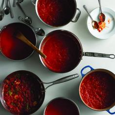 10 Foods to Calm Inflammation: tomato sauce, edamame, curry, pineapple, salmon, sunflower seeds, oatmeal, walnuts, tart cherry juice, yogurt