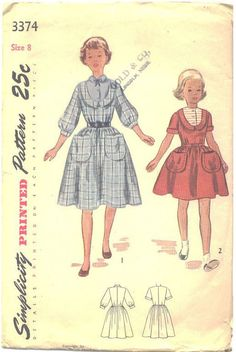 Vintage Original Simplicity Girls Dress Sewing pattern. One piece knee length dress with horseshoe yoke and high neckline. The softly gathered skirt is trimmed with two large patch pockets. Style 1. h