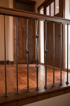 Stair Systems | wrought iron balusters with pre-finished handrail | Bayer Built Woodworks, Inc.