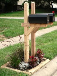 I like those mailbox posts...not with a black mailbox.  Wood mailbox would be better.