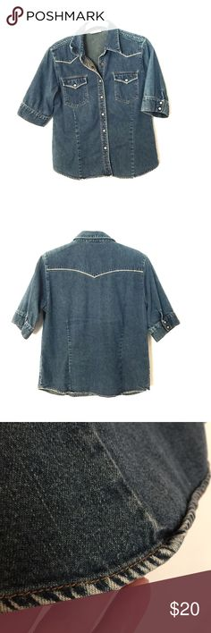 """Vintage Wrangler women's denim top. This vintage Wrangler women's denim top has darts in the front and back, giving it a slightly fitted form. The top stitching is tan. The front has pearl snaps, not buttons, and the snaps have a W in them. The bust is 19"""" measured flat and the length is 23"""" from the middle of the shoulder to the bottom. It is in great vintage condition and the bottom hem is nicely distressed. Wrangler Tops"""