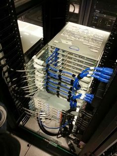 Perfect server rack cabling. Server slide rails and routers all stacked perfectly.