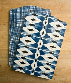 Adorable patterned cutting boards would liven up my boring kitchen, especially if hung by pegs on the wall.
